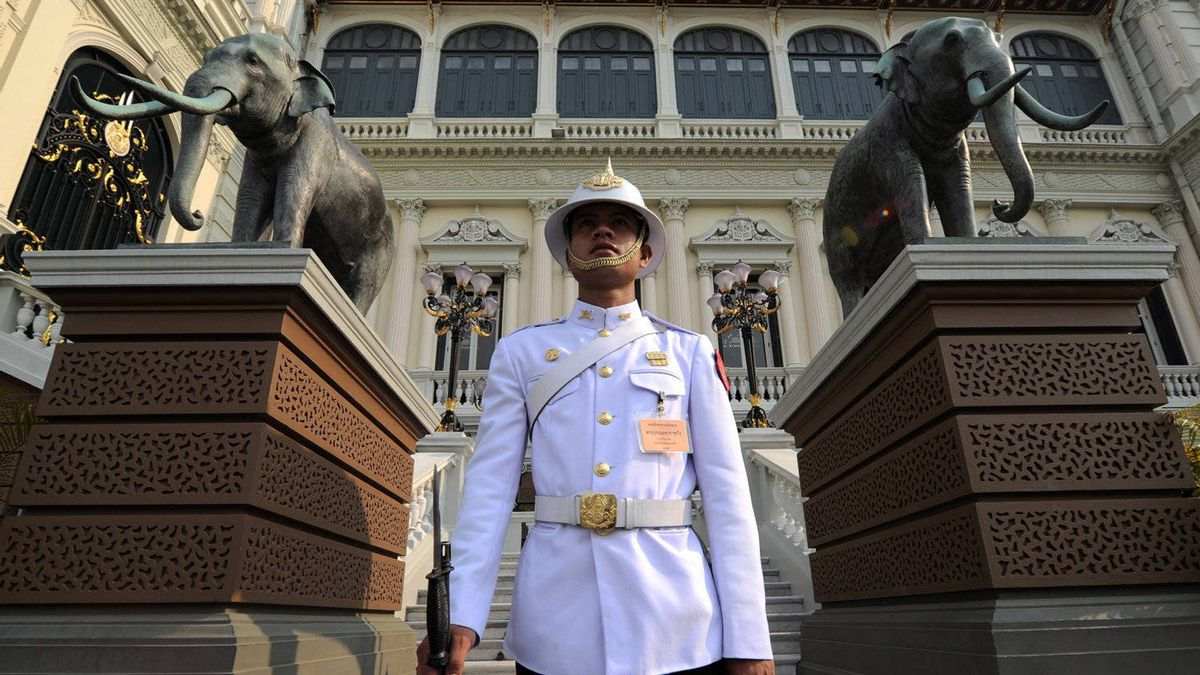 A guard watches over the Grand Palace in Bangkok, Thailand on Friday, March 23, 2012.