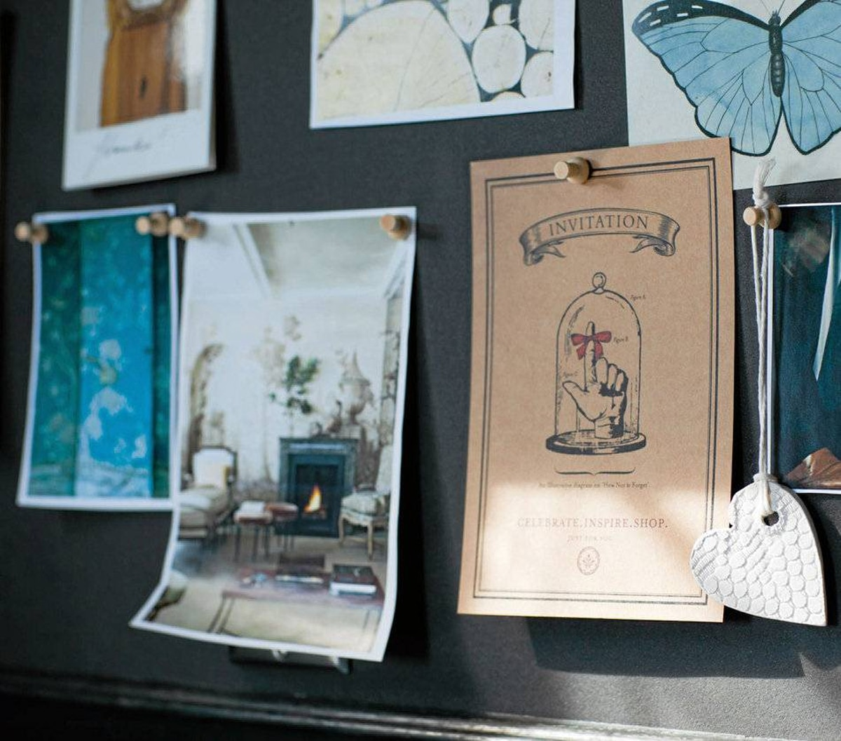 The pinboard frame's profile is the same as the wall panelling; the 'self-healing' corkboard colour matches the wood stain.