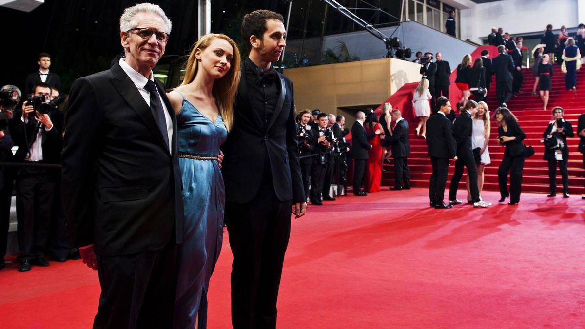 David Cronenberg, left, Sarah Gadon and Brandon Cronenberg represent Canada in Cannes as they walk the red carpet for Antiviral. While shooting photos from this angle I was being yelled at by a security person who felt that I should not be on the carpet itself taking photos, but rather in the pit with the other photographers. I let him know I did not agree, and carried on.