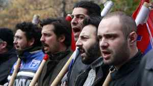 Demonstrators from the communist-affiliated trade union PAME march to the parliament in protest against the new austerity measures in Athens Feb. 7, 2012.