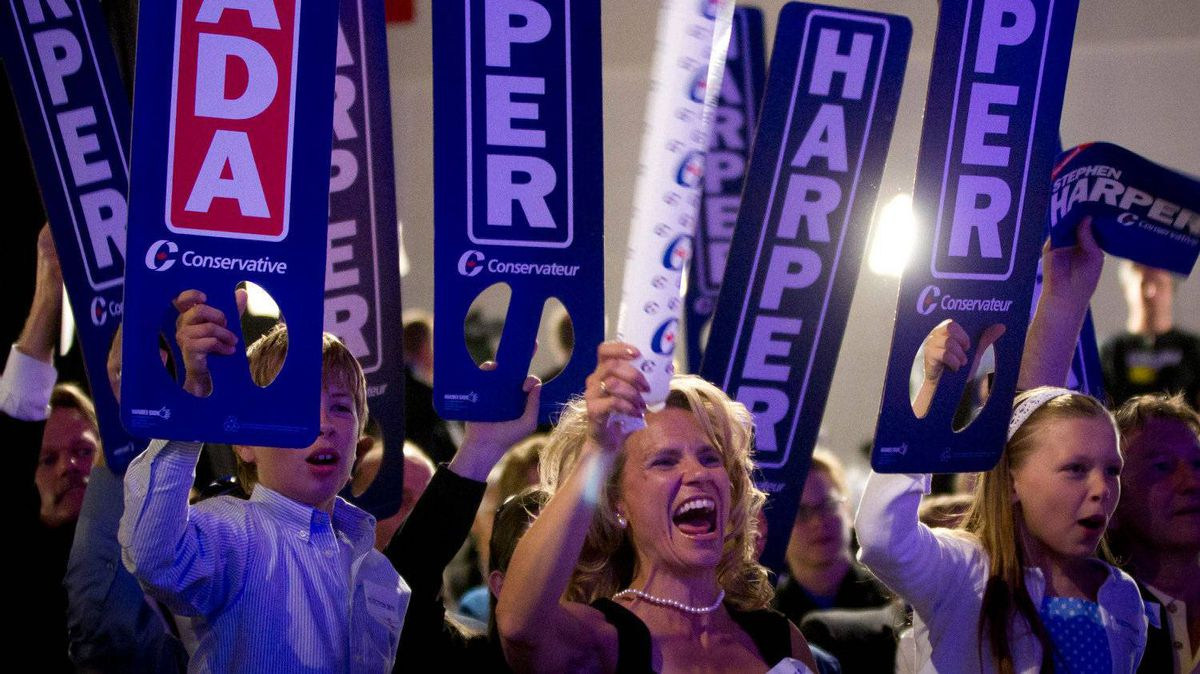 Conservative supporters cheer as they watch and wait for election results in Calgary May 2, 2011 after Canadians went to the polls in the federal election.