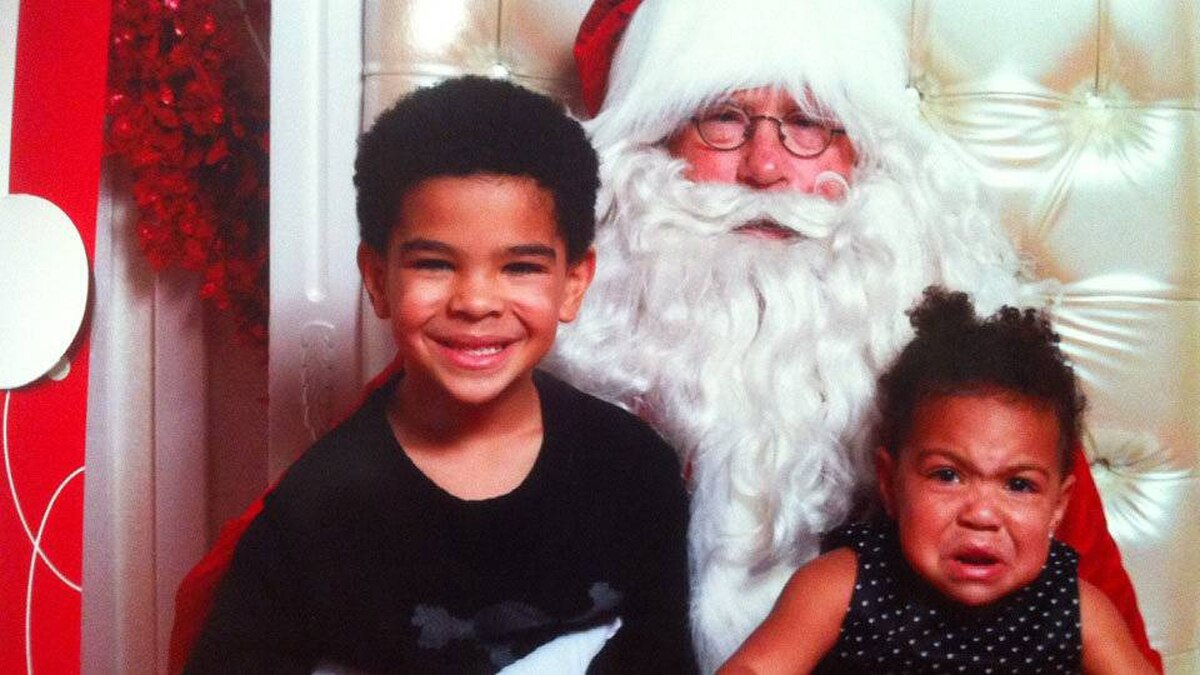 Lindsey Swinton writes: Here is our picture with Santa this year: Bishop, age 6, and Isis, age 22 months