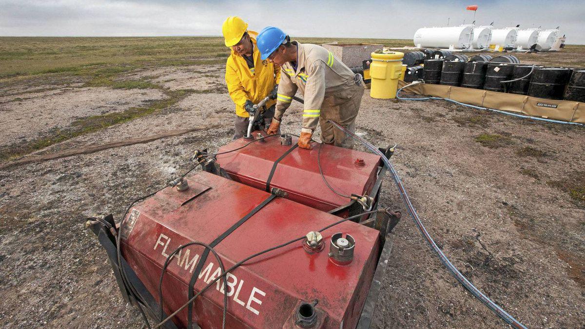 Two local men work at the fuel storage site at the proposed Kiggavik uranium mine, near Baker Lake, Nunavut.