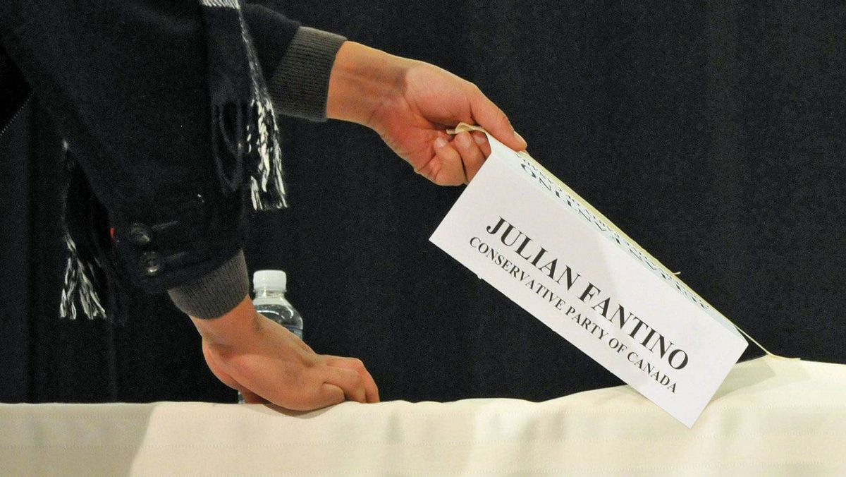 In a photo supplied by the Liberal Party, Conservative candidate Julian Fantino's name tag is removed after he failed to show up for a debate in Vaughan, Ont., on Nov. 24, 2010.
