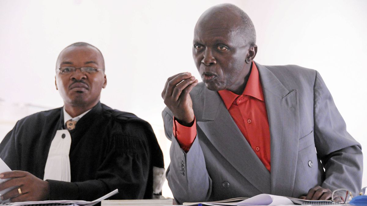 Leon Mugesera, right, and his Rwandan attorney, Donat Mutunzi, in court in Kigali, Rwanda, on April 2, 2012.