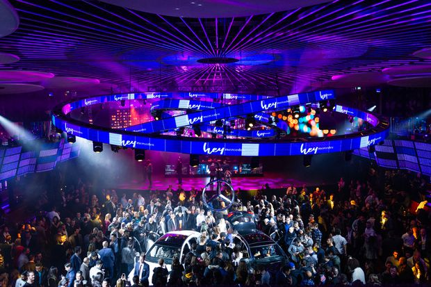 """f20f01edc01 People mingle at a nightclub launch event for Mercedes called """"Hey  Mercedes! Set the Mood."""""""