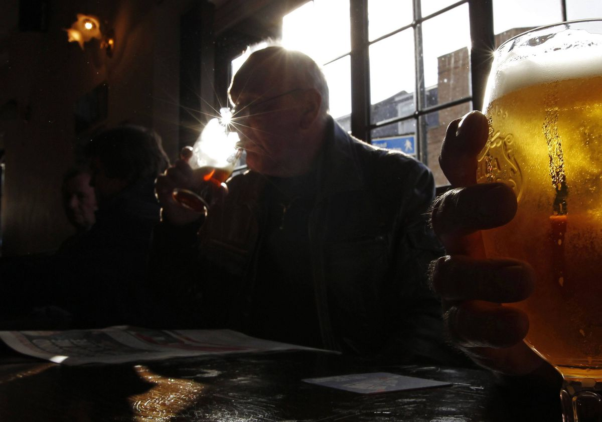Customers drink in the Albert pub in east London. The pub is located on Roman Road which dates back to Roman times, forming the London to Colchester road.