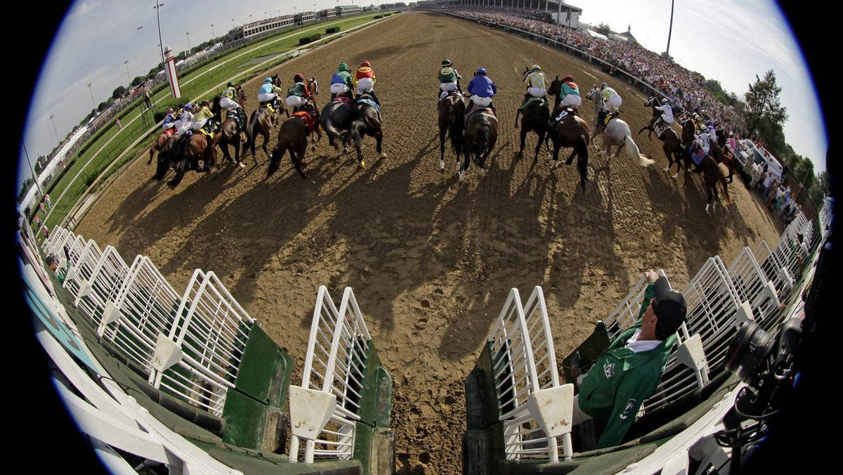 In a photo taken with a fish eye lens, horses leave the starting gate in the 138th Kentucky Derby horse race at Churchill Downs Saturday, May 5, 2012, in Louisville, Ky. (AP Photo/Matt Slocum)