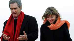 Liberal Leader Michael Ignatieff and his wife Zsuzsanna Zsohar walk to a Tim Horton's during a campaign stop in Conception Bay, Nfld, on April 5, 2011.