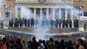 Riot police protects the parliament during violent protests in Athens' Syntagma square, June 29, 2011. Greece's parliament has approved unpopular austerity measures on Wednesday, despite violent protests, to secure international funds to prevent the euro zone's first sovereign default.