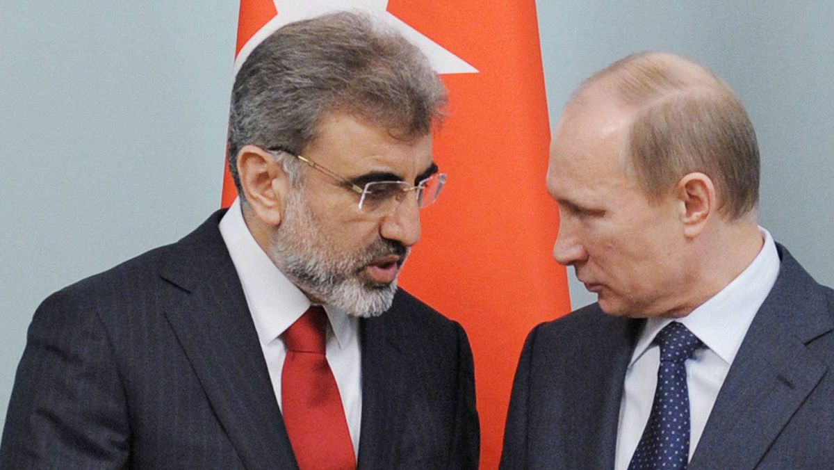 Turkish Energy Minister Taner Yildiz speaks with Russian Prime Minister Vladimir Putin during their meeting in Moscow, Dec. 28, 2011.