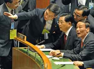 President Hu Jintao and Chinese officials listen to proceedings at the United Nations summit on climate change in New York on Sept. 22, 2009.