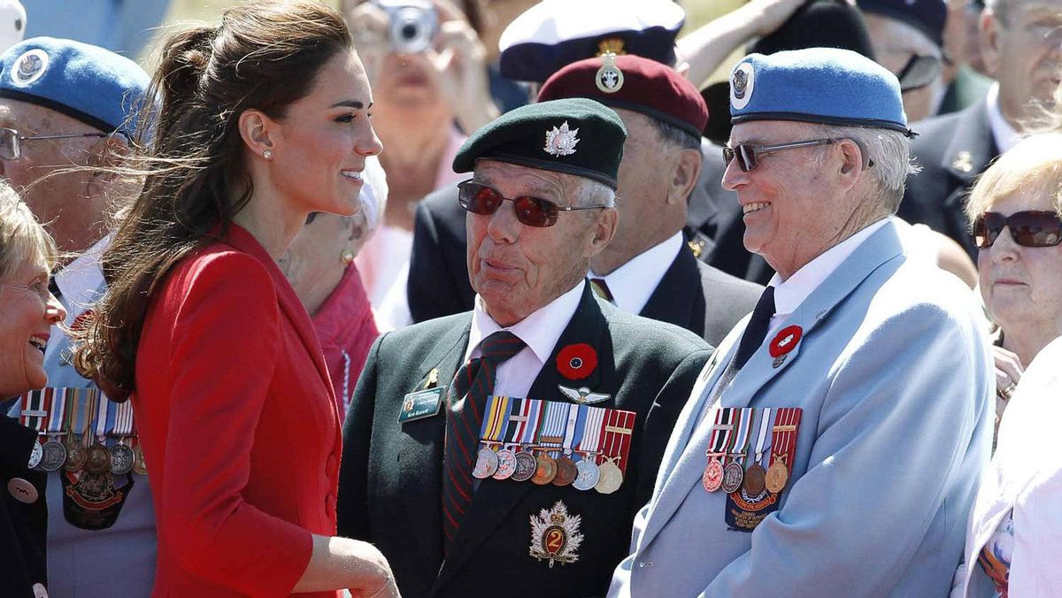 Catherine, Duchess of Cambridge, speaks with veterans during an official departure ceremony in Calgary, Alberta, July 8, 2011.