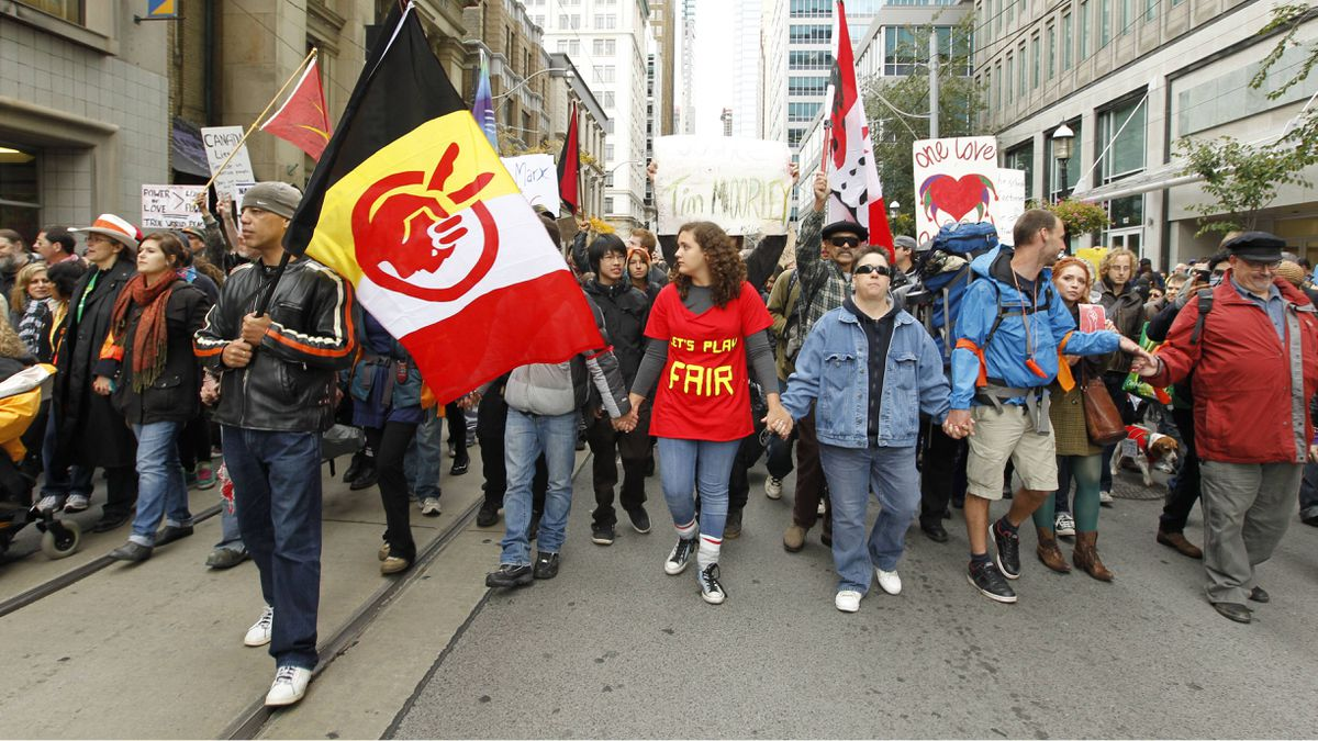 Protesters march in the streets of downtown Toronto during the Occupy Toronto protests on October 15, 2011.