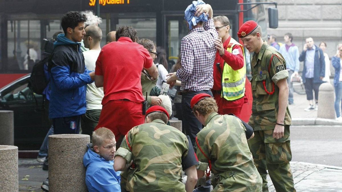 Military personnel work at the scene of a powerful explosion that rocked central Oslo July 22, 2011.