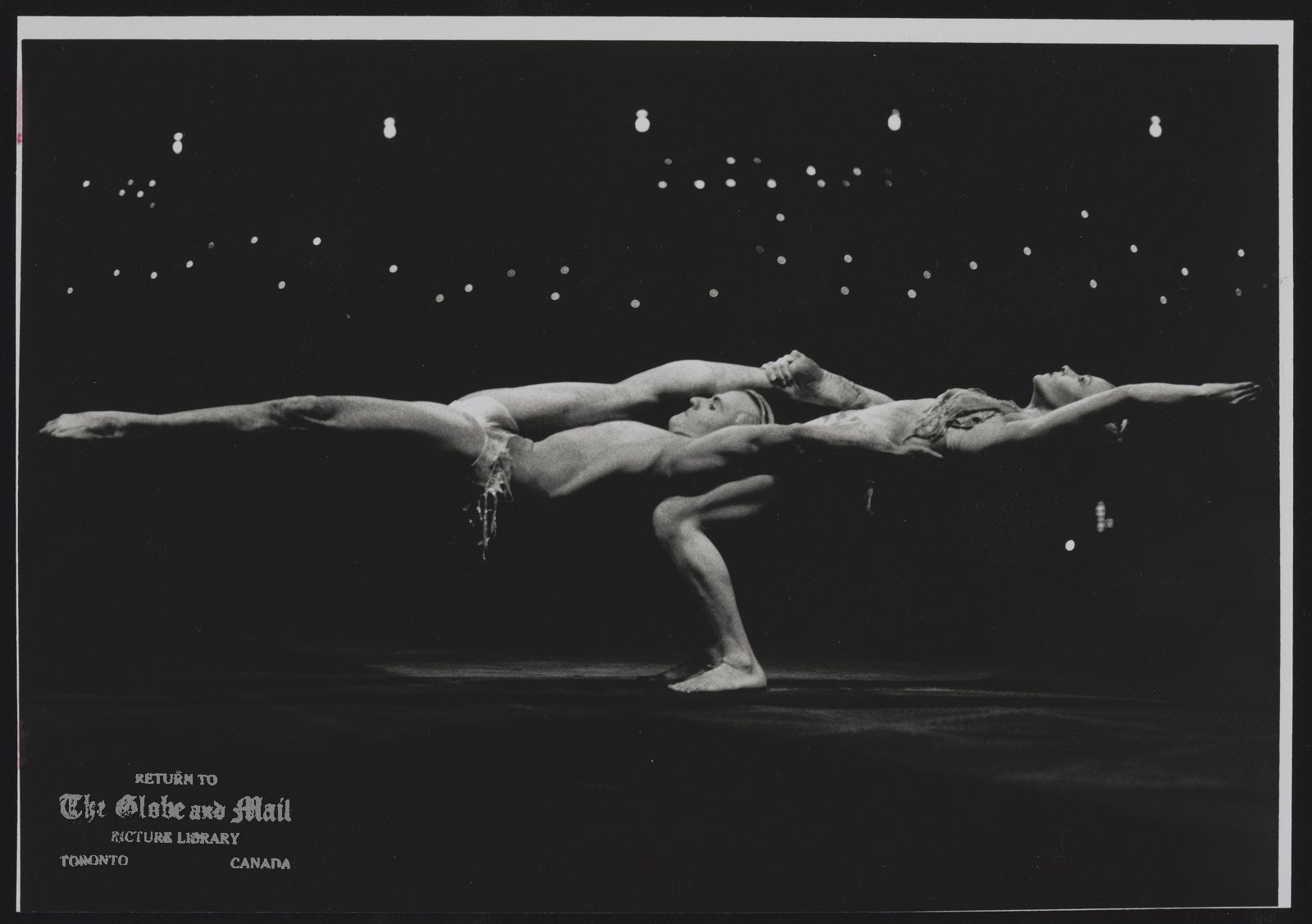 CIRQUE DE SOLEIL YVES DECOSTE AND MARIE-LAURE MESNAGE PERFORM A DECEPTIVELY SIMPLE GYMNASTIC ROUTINE IN WHICH THEY CARRY THE ENTIRE WEIGHT OF EACH OTHER ' S BODY ON SHOULDERS OR THIGHS.