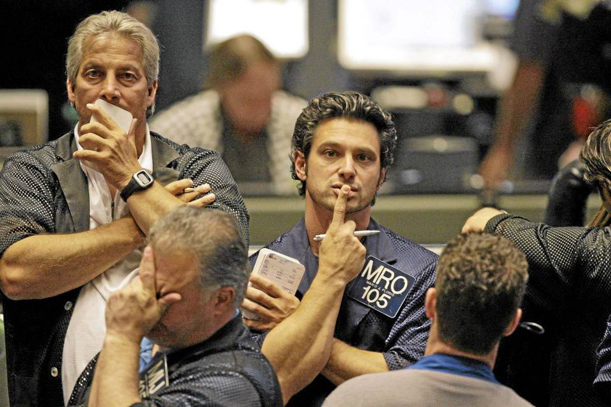 Traders James J. Marchese, foreground, and Mario J. Florio, center, reacts in the S&P 500 futures pit at the CME Group in Chicago near the close of markets, Thursday, May 6, 2010.