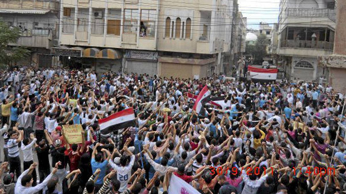Demonstrators protesting against Syria's President Bashar al-Assad march through the streets in Homs September 30, 2011. Picture taken September 30, 2011.