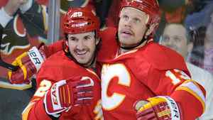 Calgary Flames' Curtis Glencross, left, celebrates his first goal against the Chicago Blackhawks with Olli Jokinen during second period NHL action, in Calgary, Alta., Friday Nov. 18, 2011. THE CANADIAN PRESS/Larry MacDougal