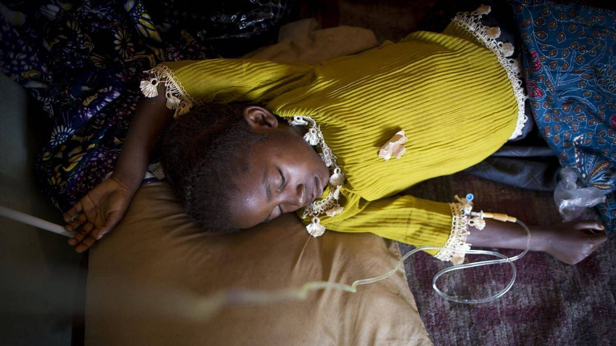 Seraphine Musomeka recovers after a blood transfusion to treat severe malaria at a hospital in Lubumbashi.