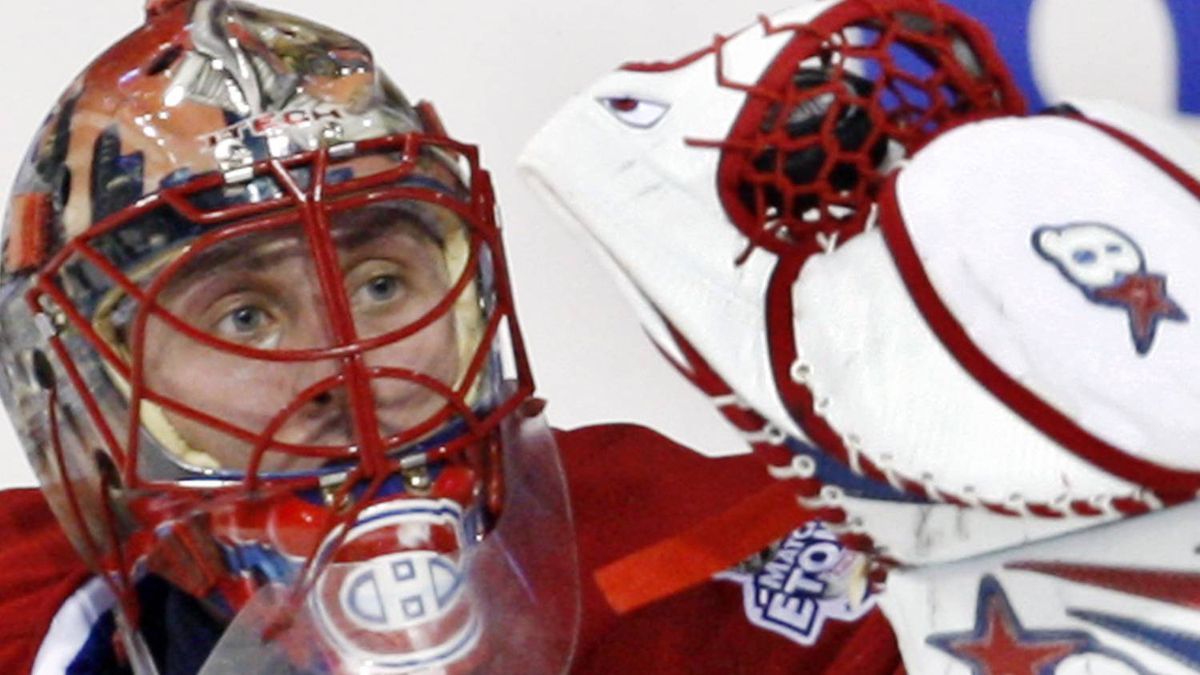 Montreal Canadiens goaltender Jaroslav Halak, from Slovakia, makes a glove save on his way to shutting out the Vancouver Canucks 3-0 during third period NHL hockey action in Montreal Tuesday, Feb. 24, 2009. THE CANADIAN PRESS/Ryan Remiorz