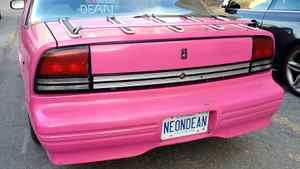 Neon Dean spent a lot of time and money on his unique vision, which includes gold windshield wipers, pink neon lights beneath the chassis and his name spelled out in pink neon.