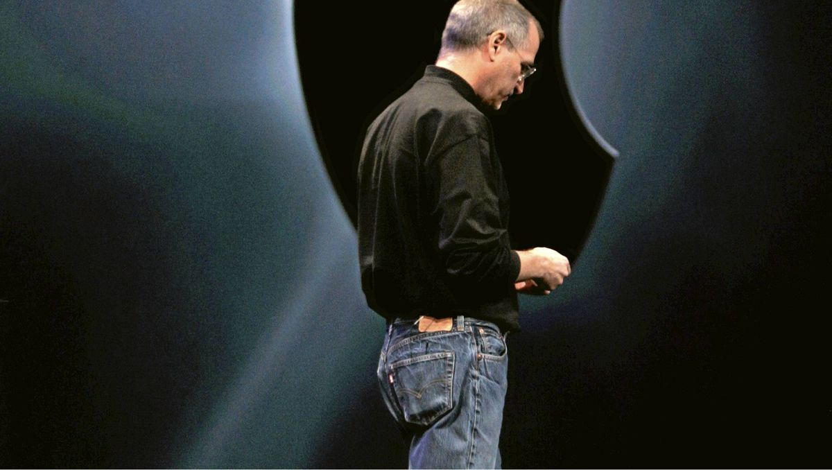 In this Jan. 9, 2007 file photo, Apple CEO Steve Jobs unveils the new AppleTV and iPhone during his keynote address at MacWorld Conference-Expo in San Francisco.
