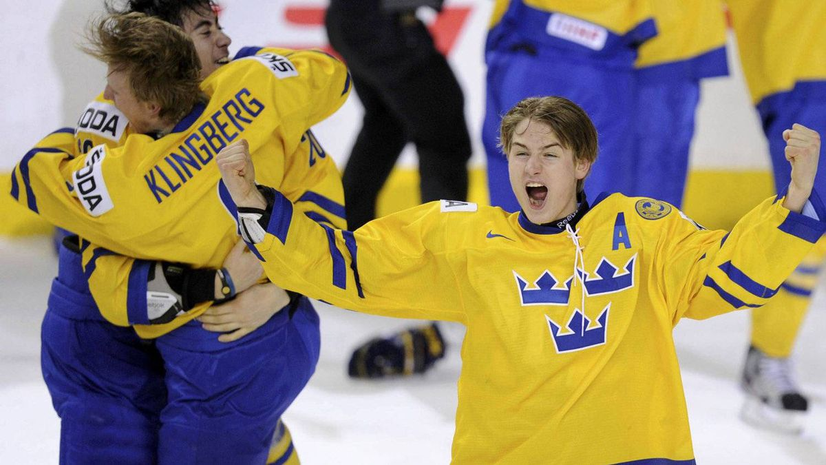 Sweden's Johan Sundstrom celebrates with teammates after defeating Russia in overtime in the gold medal game of the 2012 IIHF U20 World Junior Hockey Championships in Calgary.