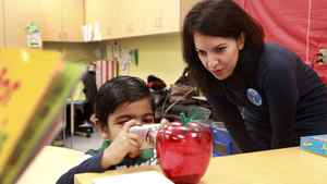 Prathmesh Mistry takes photos of his favourite things in his Junior Kindergarten class with researcher and OISE graduate student Kadria Simons. Photo: Anne-Marie Jackson/ The Globe and Mail