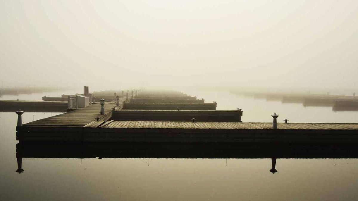 This photo was taken in March of 2012 at 9:36am at the Bronte Marina in Oakville, ON. It was a still morning as the fog was thick draping over the harbour. Taken with a Nikon D7000.