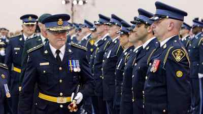 New OPP Commissioner Chris Lewis, left, inspects a line of officers during the Change of Command ceremony in Toronto Tuesday, August 31, 2010.