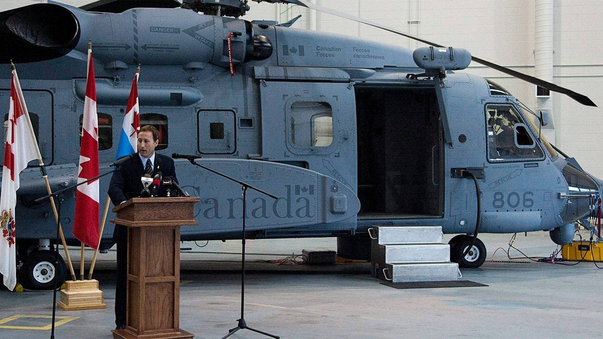 Defence Minister Peter MacKay addresses crew and technicians after inspecting a new Sikorsky CH-148 Cyclone helicopter at CFB Shearwater outside Halifax on May 26, 2011.