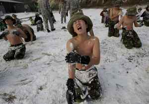 South Korean elementary and middle school students rub their bodies with the snow during a winter military camp for kids at the Cheongryong Self-denial Training Camp on Daebu Island in Ansan, Monday, Dec. 27, 2010. Some 50 students took part in the three-day camp as a way to mentally and physically strengthen themselves. (AP Photo/Ahn Young-joon)