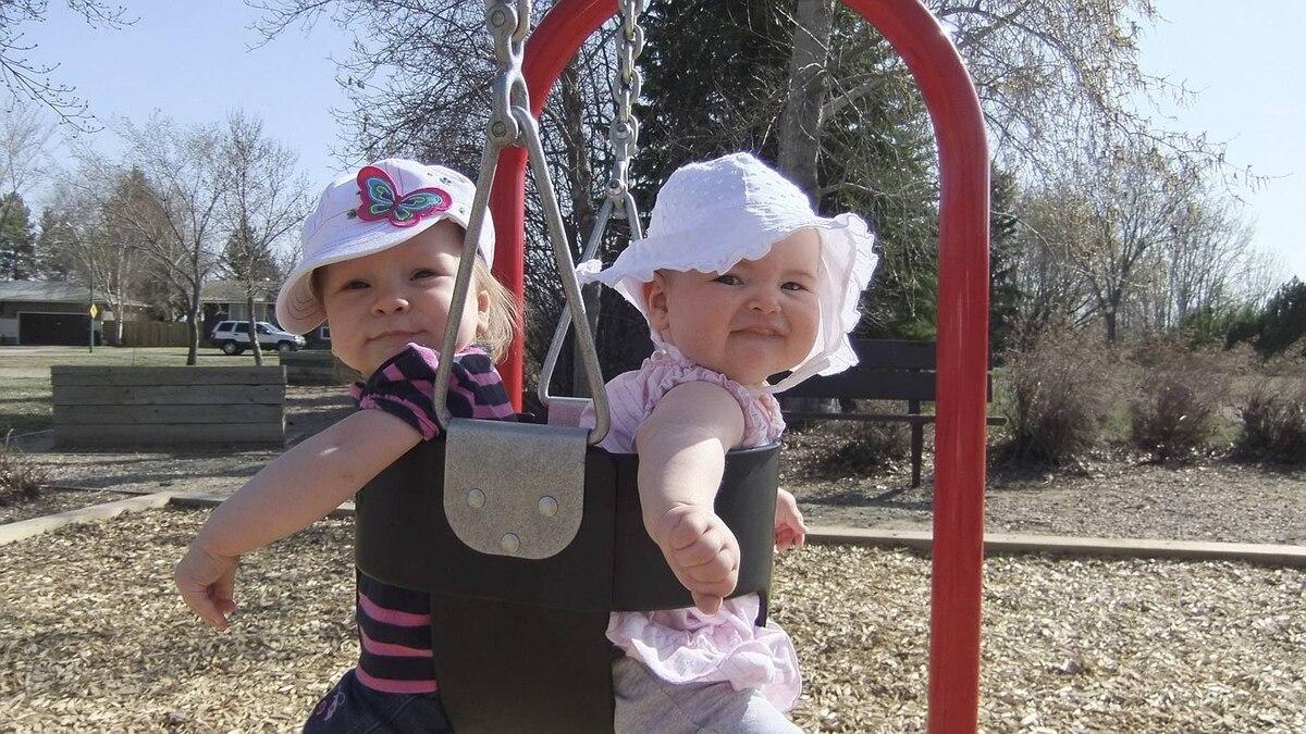 Carey Hyndman photo: Two in a swing - Morgan and Haven enjoying summertime in Saskatoon!