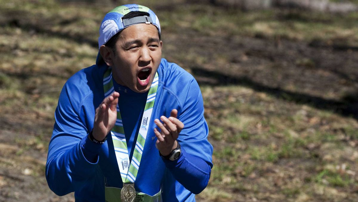 Jeremiah Sacay cheers on runners at Harry's Spring Run-Off.