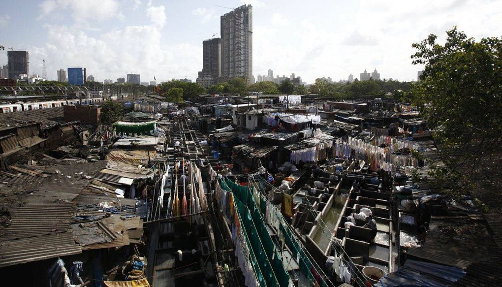 mumbai boasts the world s largest open air laundry the globe and   the dhobi ghat open air laundry in mumbai