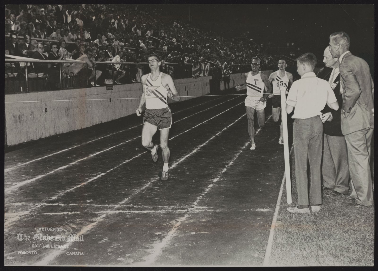 Bill CROTHERS Sprinting to the front on the last lap, Crothers easily wins mile race in 4:02.4 at Police Games.