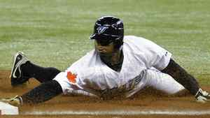 Toronto Blue Jays base runner Rajai Davis slides back into first base ahead of the tag by Minnesota Twins pitcher Carl Pavano (L) during a run down between first and second base in the first inning of their MLB American League baseball game in Toronto April 1, 2011. REUTERS/Mike Cassese