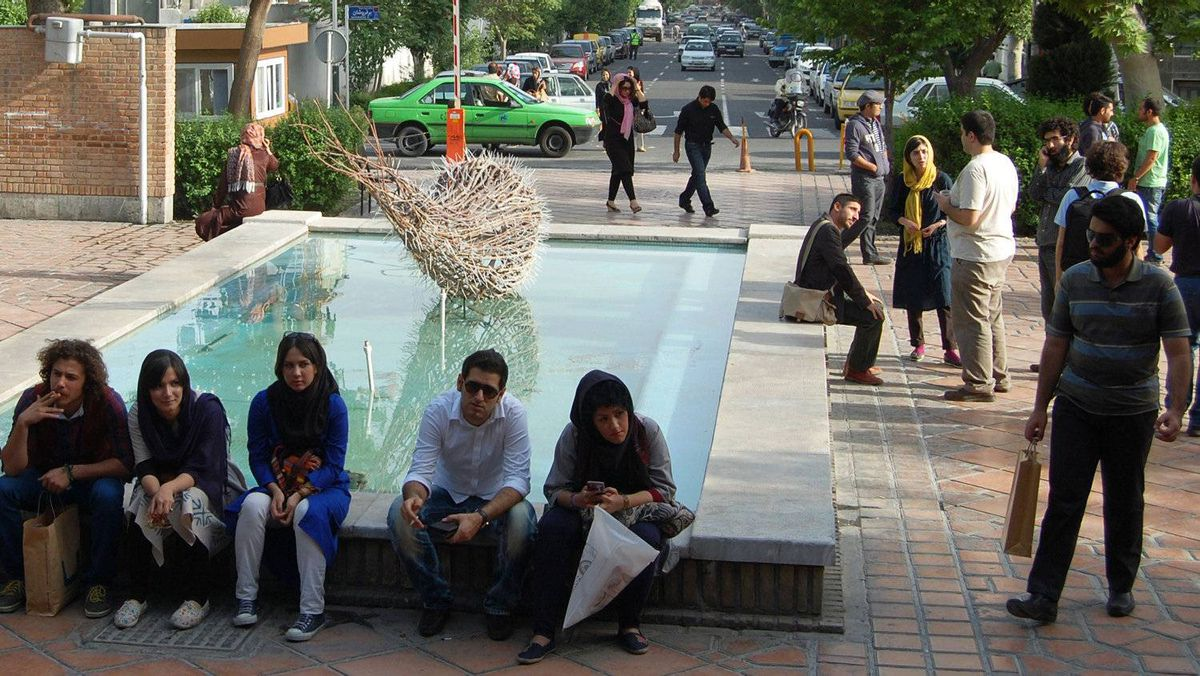 Iranian youth spend time in an art park.