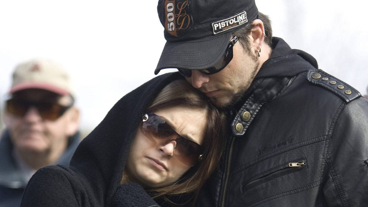 Jessica Murphy gets hugged by her boyfriend Yves Lavigne during a rally Friday for the victims of Russell Williams in downtown Belleville, Ont.,