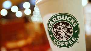 A cup of Starbucks coffee sits on a table in a cafe in central Hong Kong January 16, 2011.