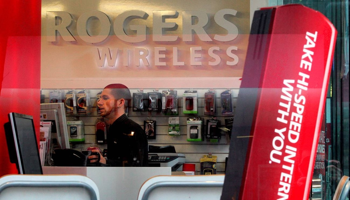 An employee works inside a Rogers Wireless retail store in Vancouver, B.C..