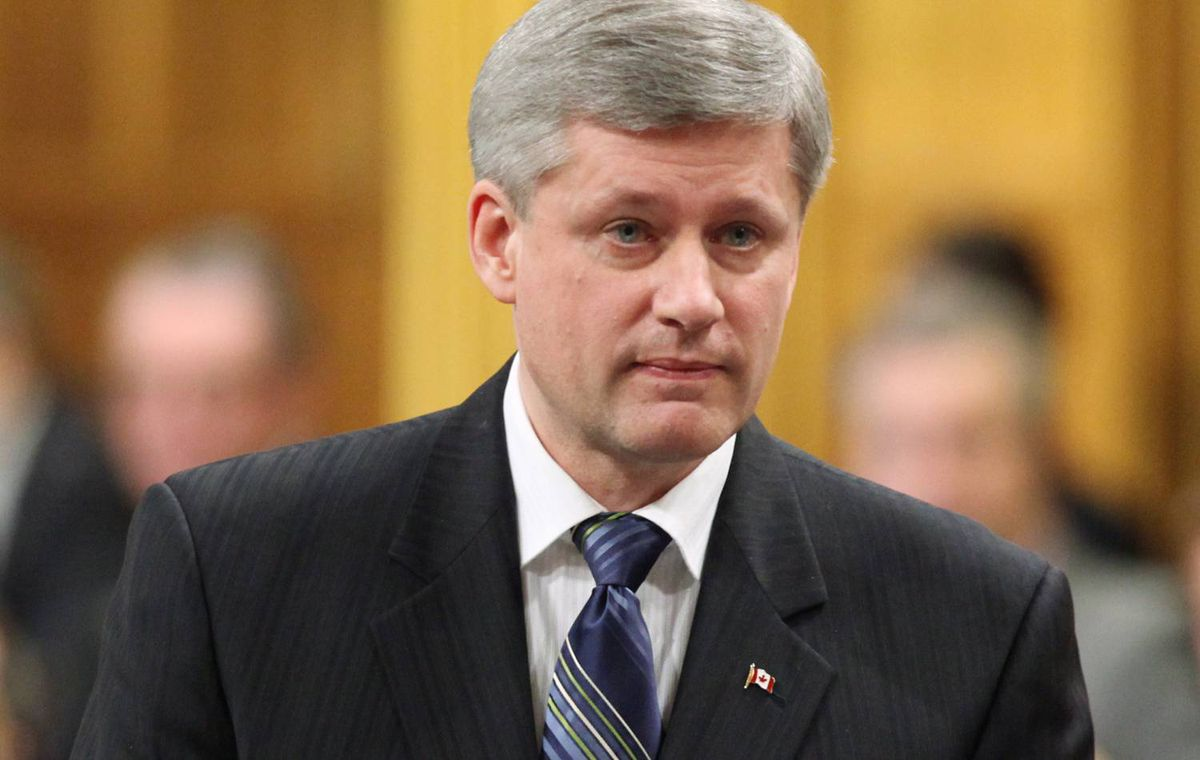 Prime Minister Stephen Harper stands in the House of Common during Question Period on Tuesday November 24, 2009.