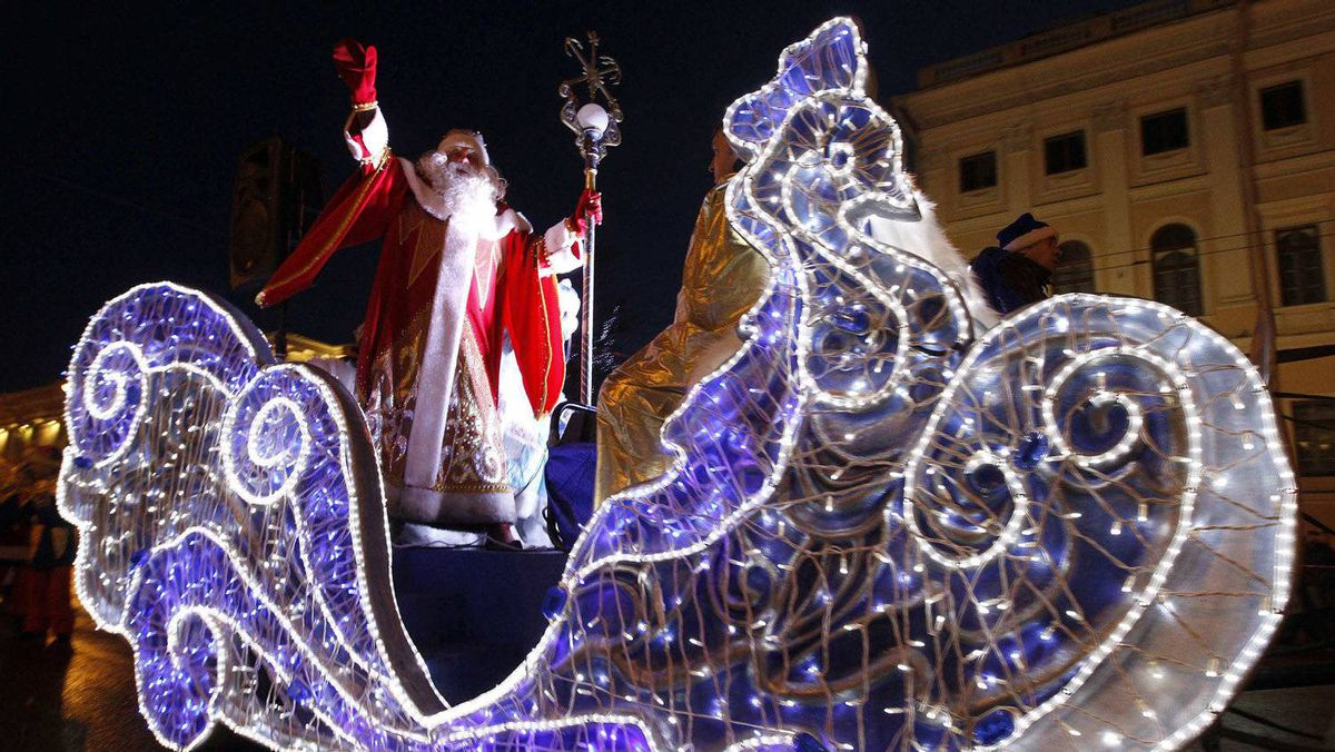Father Frost, the Russian equivalent of Santa Claus, greets people during a parade in central St. Petersburg, December 25, 2011. Russians traditionally celebrate the coming of the New Year on December 31 and Orthodox Christmas on January 7.