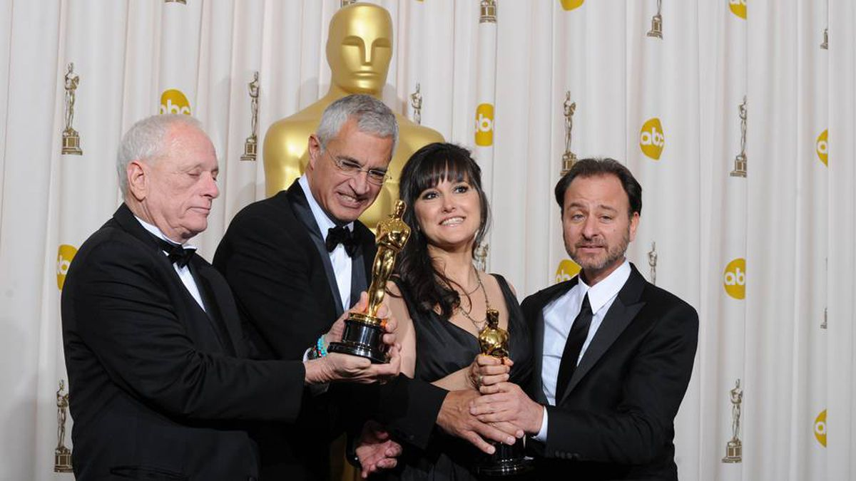 "Best documentary feature winners (from left) Richard O'Barry, director Louie Psihoyos, producer Paula DuPre Pesman and actor Fisher Stevens from the film ""The Cove,"" display their Oscar at the the 82nd Academy Awards in Hollywood March 7, 2010."