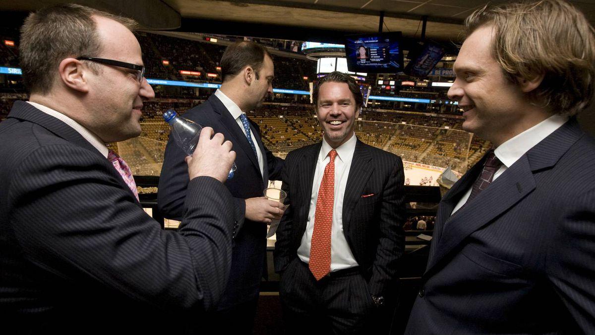 Ice Edge Holdings chairman Keith McCullough, second from right, laughs while joking with partners, from left to right, CEO Anthony LeBlanc, COO Daryl Jones, and CFO Todd Jordan in a suite at the ACC during NHL regular season action between the Phoenix Coyotes and Toronto Maple Leafs on Wednesday, December 16, 2009. Darren Calabrese for The Globe and Mail