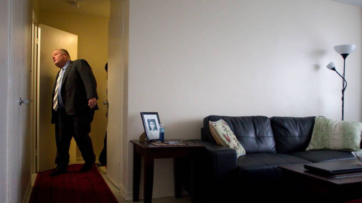 Toronto's Mayor Rob Ford inspects a resident's apartment during a tour of a Toronto community housing building in the city's east end on Feb. 16, 2012 .