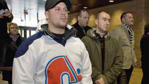 Nordiques fans watch a news conference by Quebec City mayor Regis Labeaume on his desire to build a new NHL-calibre arena in the provincial capital on Oct.16, 2009.