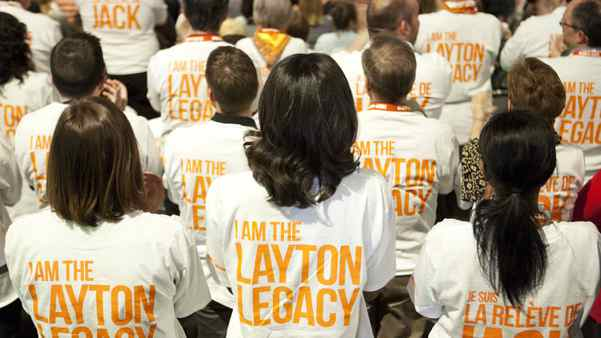 People watch a special tribute to NDP leader Jack Layton, who passed way last year, during the NDP leadership convention in Toronto on Friday, March 23, 2012.