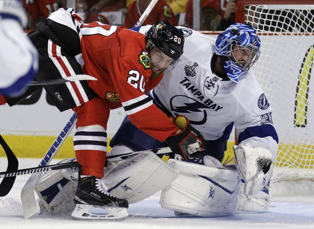 4894ea7b Chicago Blackhawks' Brandon Saad, left, collides with Tampa Bay Lightning  goalie Ben Bishop during the second period in Game 6 of the NHL hockey Stanley  Cup ...